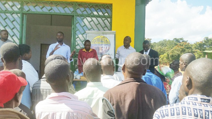 The officials interact with some of the farmers during the  launch and awareness meeting
