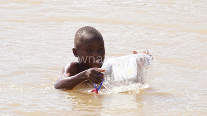 A boy is seen swimming in the dam