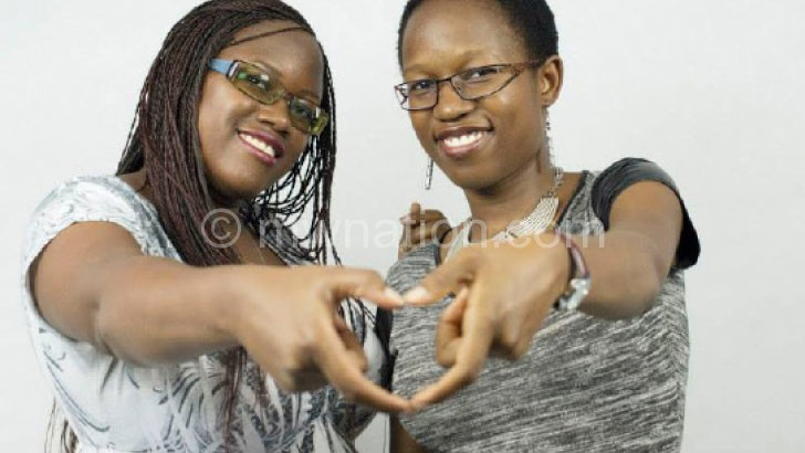 Ekari (R) shares a lighter moment with her twin sister
