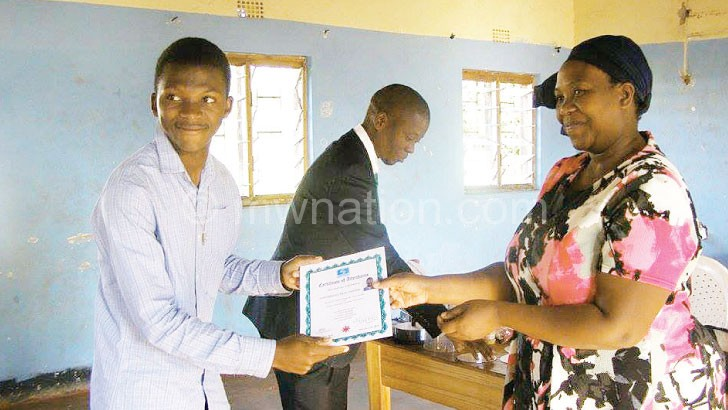 Empowered: One of Simtech students receives a certificate after graduating