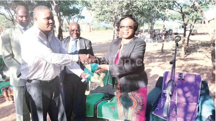 Tembo (R) hands over keys to Ngozo