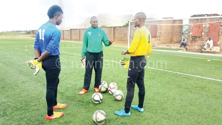 Dropped: Munthali (L) and Soko (R) with goalkeeper trainer  Swadick Sanudi during training