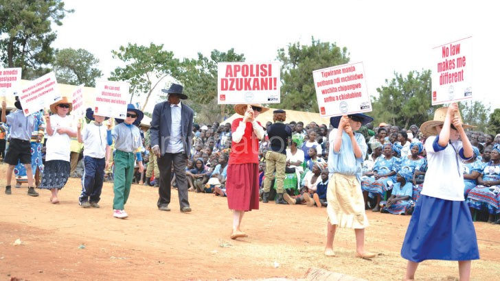 Children with albinism carry placards yesterday