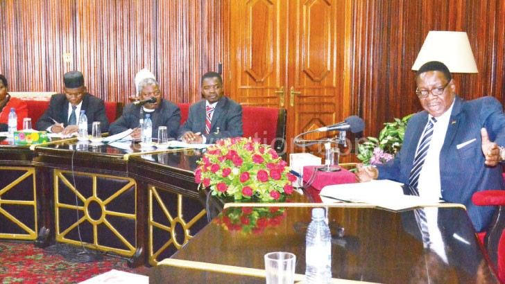 Mutharika (R) meets the dialogue team at State House in this file photo