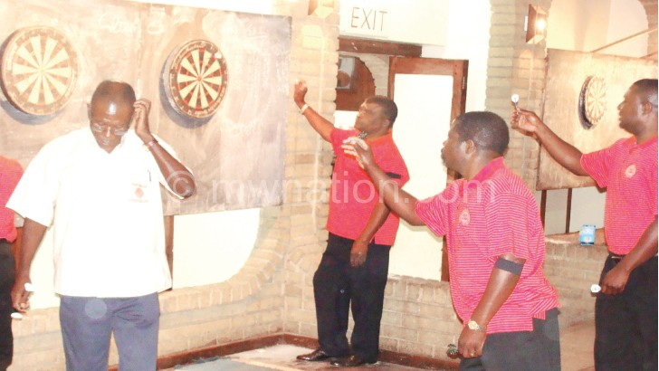 Darts players  in action in a  previous tournament