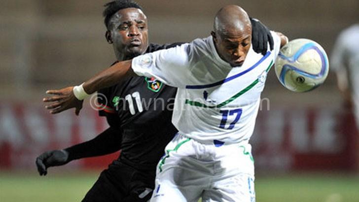 Flames striker Frank 'Gabadinho' Mhango (No. 11) in action against Lesotho