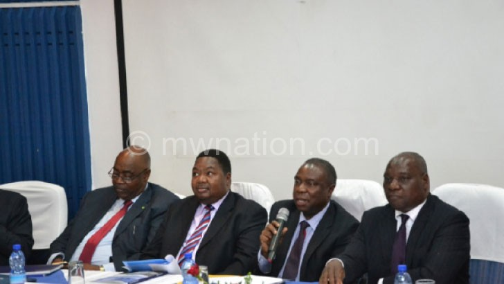 PCL CEO Chikaonda (2ndR) stresses a point flanked by Khembo (R) and other directors