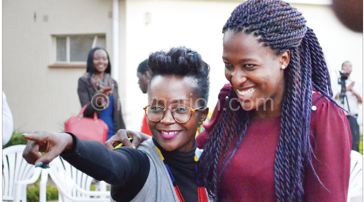 Kansiime poses with journalist Olivia Mgusha after the interviews