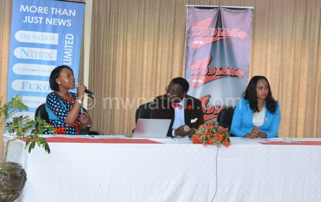One of the judges Blandina (L) stresses a point as fellow judges Mijiga (C) and Chihana pay close attention