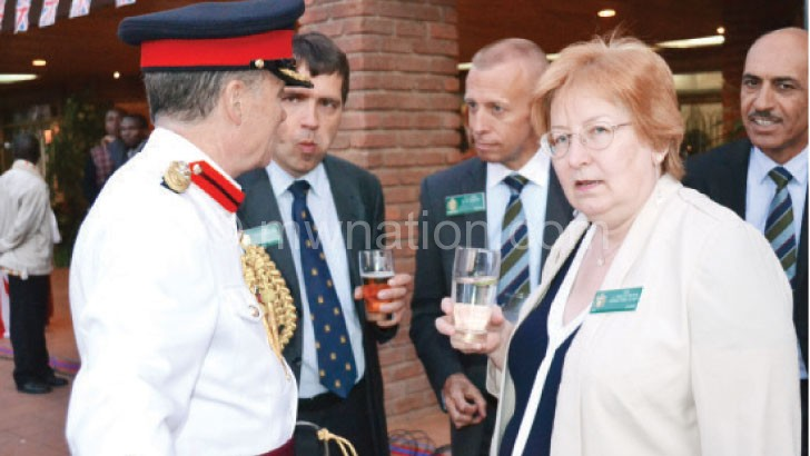 Some of the guests toast to the Queen's health during the celebrations