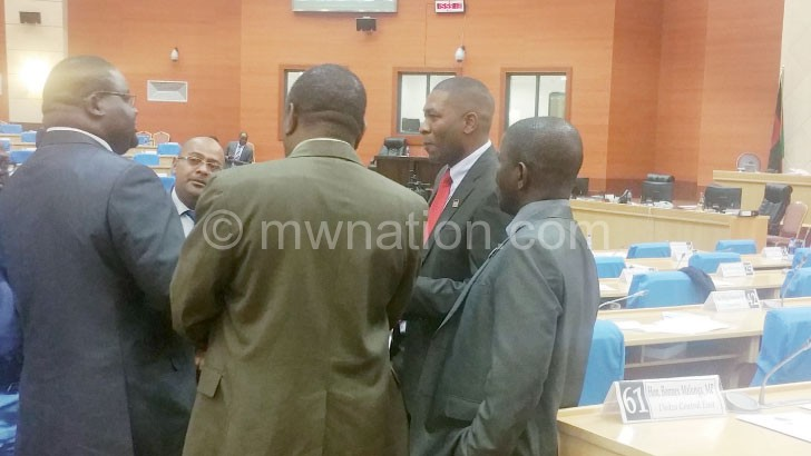 Media Committee members confer after the process was halted