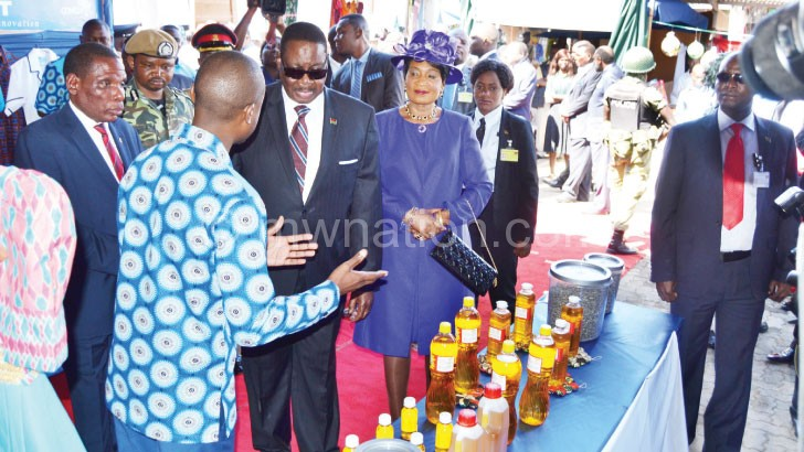 Mutharika and the First Lady appreciate some of the products at the Trade fair