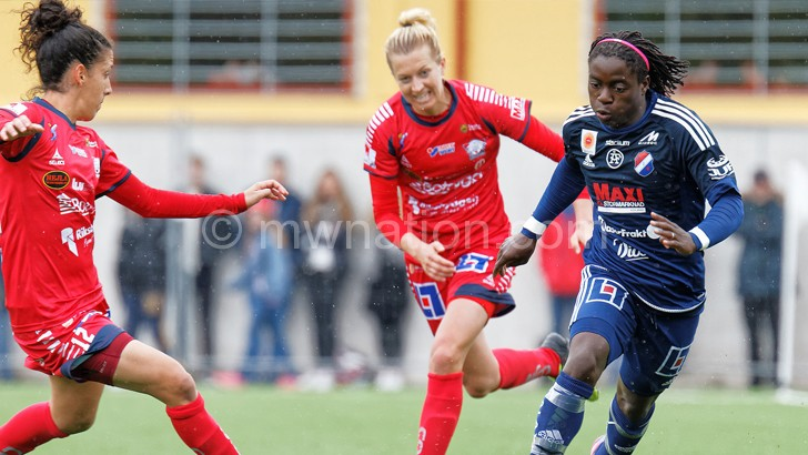 Chawiga (R) tries to dribble past her opponents during a Swedish league match