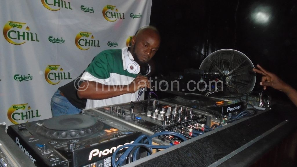 Ernie the DJ mans the turntables on his way to glory