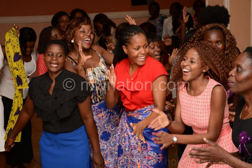 Some of the patrons rejoicing at  a previous conference