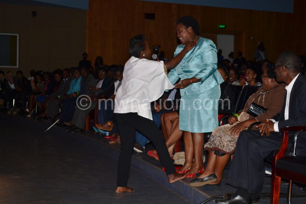 Kansiime ineracts with patron during the show
