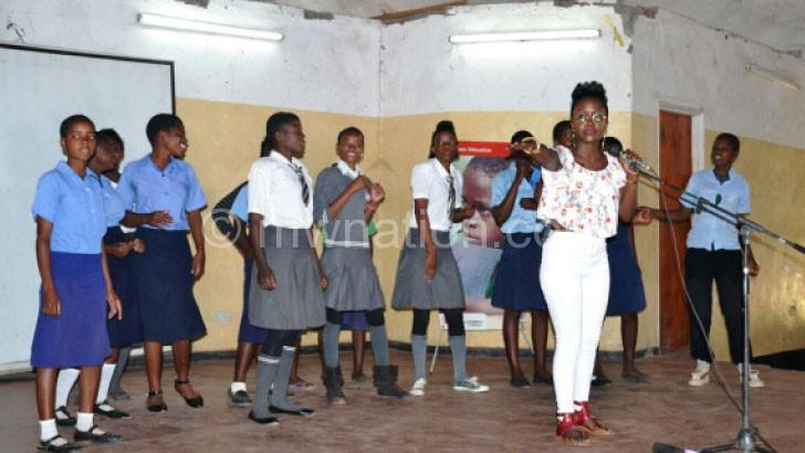 Interacting with Salima girls: Kansiime