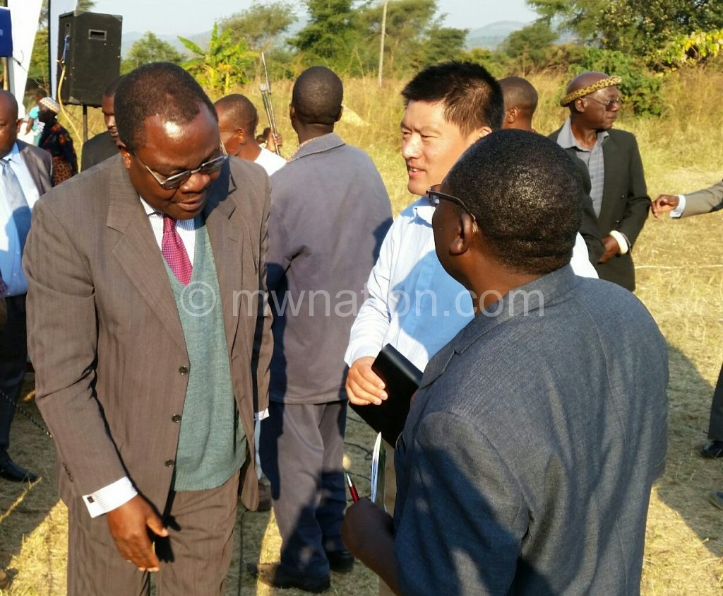 Mawindo (L) having a word with contractors