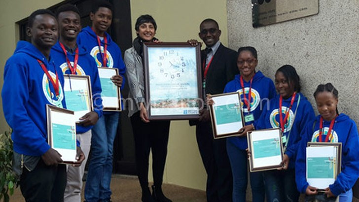 The winning students pose with British Council officials