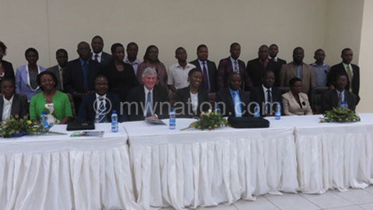 Mpico management and shareholders pose for photo