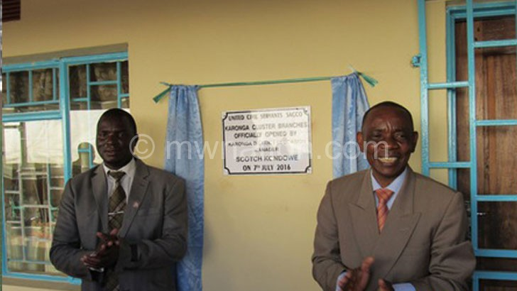 Mhango (L) and Kondowe after unveiling the merged Sacco