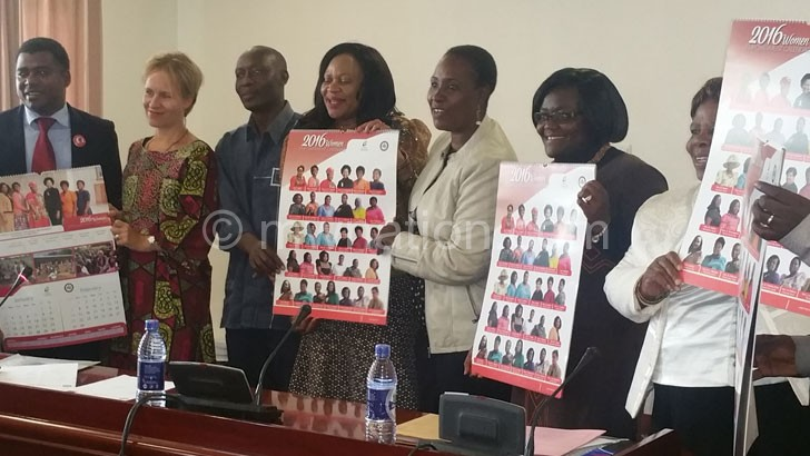 Women MPs, UN representatives and other MPs display the women caucus calendar launched on Fridaypreviously