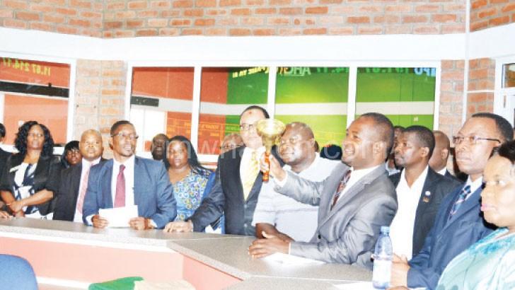Legislator Willard Gwengwe kick-starts trading by ringing a bell