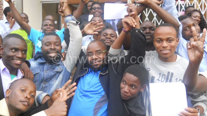 The students celebrate after being granted bail