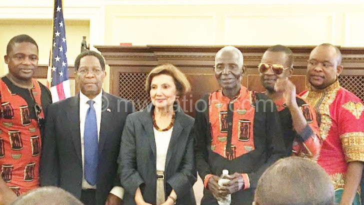 Giddes poses for a photo with Edgar (L), Davis (2nd R), Mhura (2nd L), Maloya (R) and Library of Congress' Mary-Jane Deeb