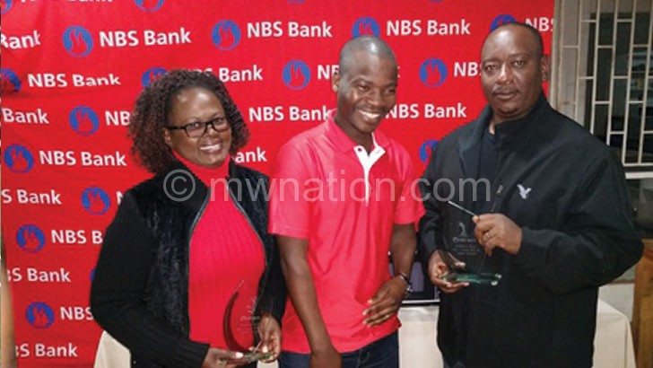 Mandala (R) and Mangwana (L) chat with Ngwira after receiving their trophies