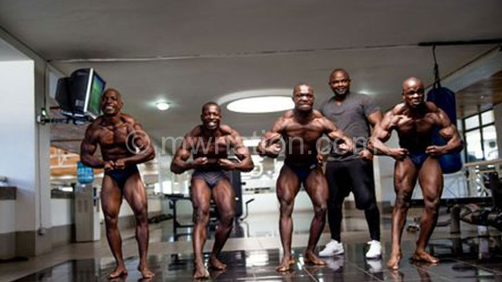 Macho-men: Ulaya (2ndR) poses with some of the bodybuilders  earmarked for the Ulayaclassic