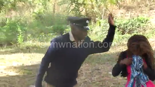 A video grab of police officers assaulting female student