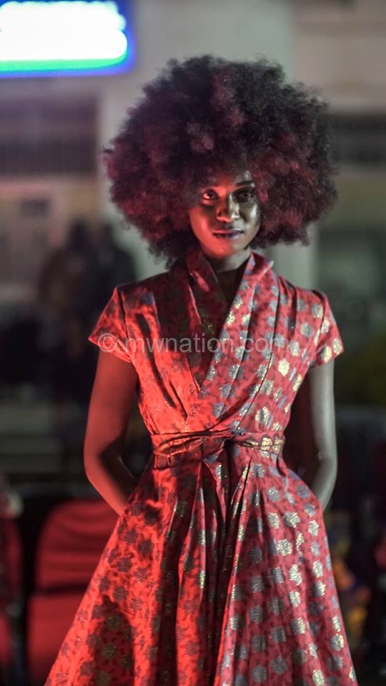 A model donning a design by Lilly Alfonso
