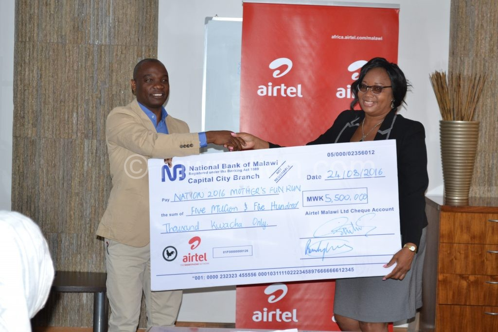 Kamoto hands over a symbolic cheque to Banda