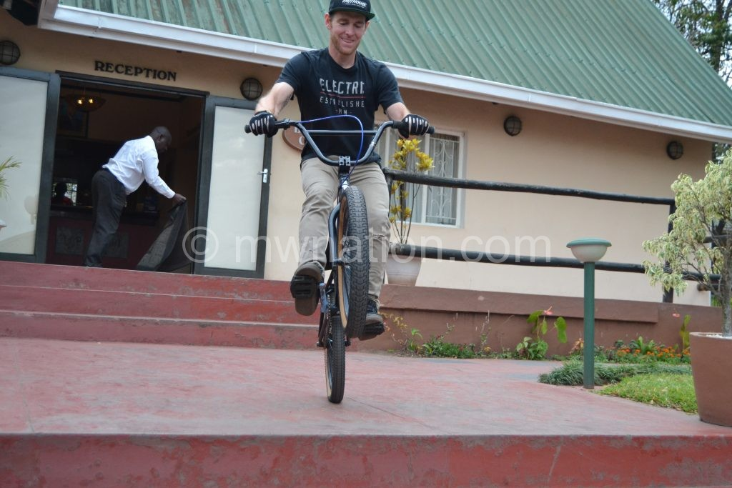 A bicycle rider shows journalists his riding skills in Blantyre on Wednesday
