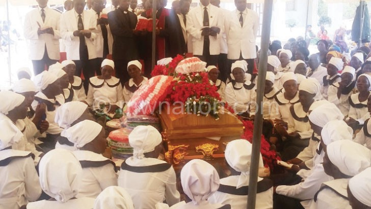 Members of the women's guild pay their last respects to Munthali