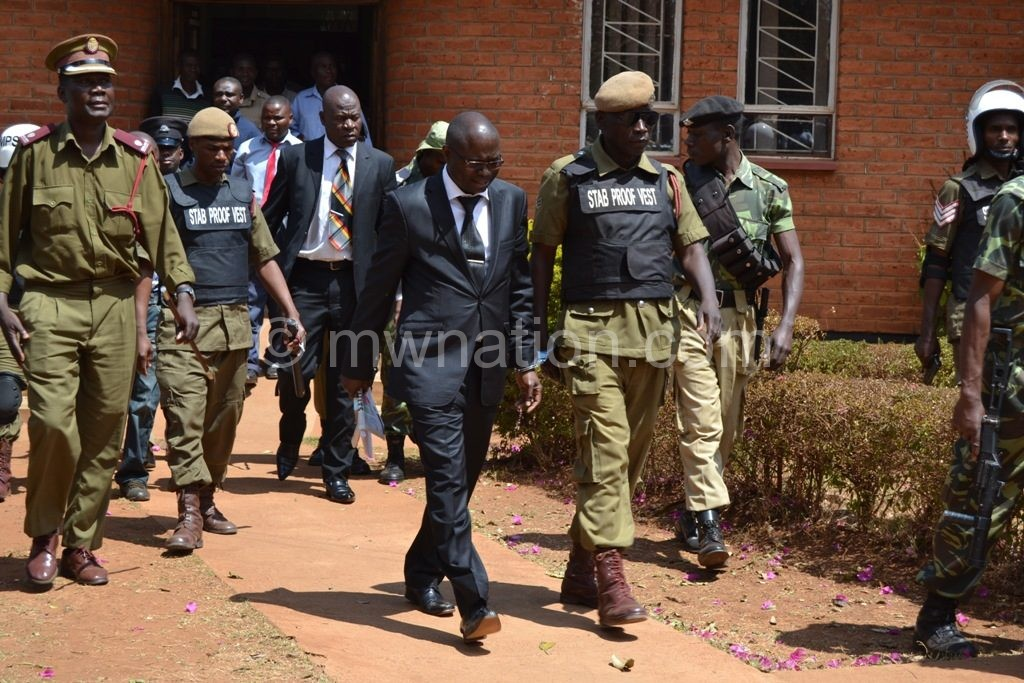 Downcast Kasambara leaves the court after the sentencing session