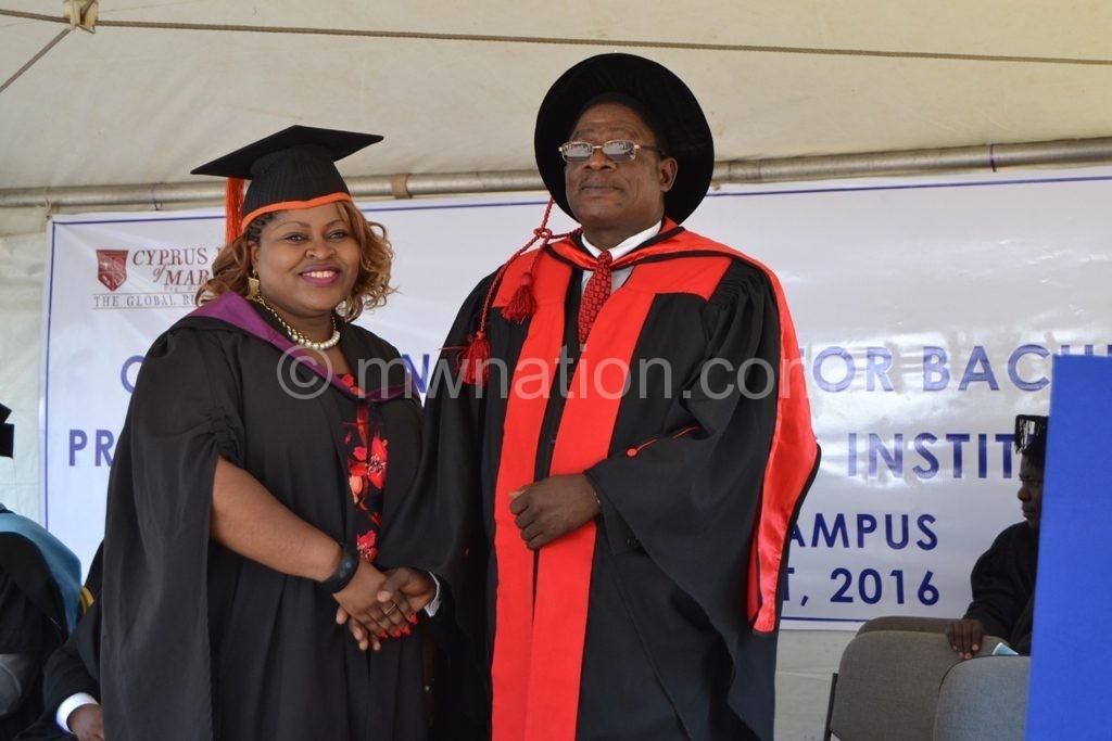 Luhanga (R) congratulates one of the graduands