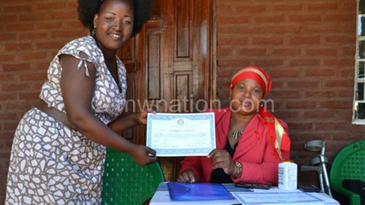 Ali (R) presents a certificate to a past participant