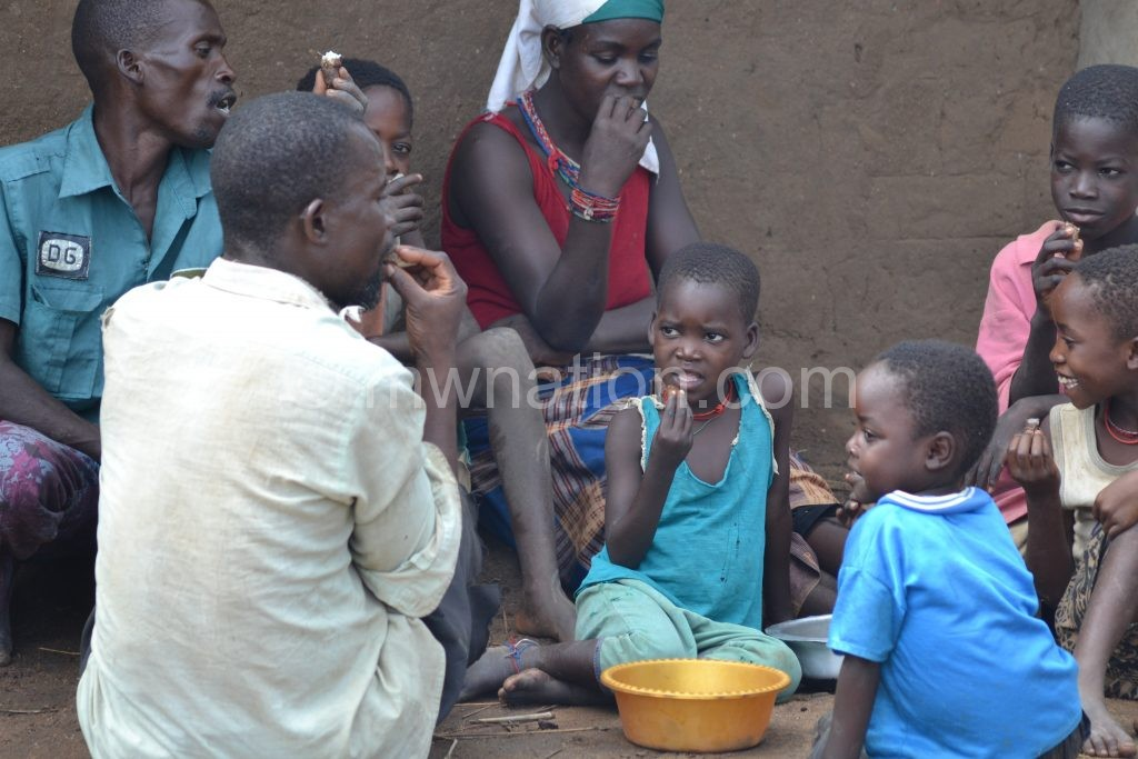 A family shares a meal: Many Malawians face hunger this year