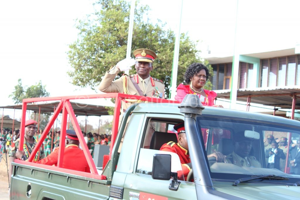 Supuni-Phiri and his wife being escorted out of the parade