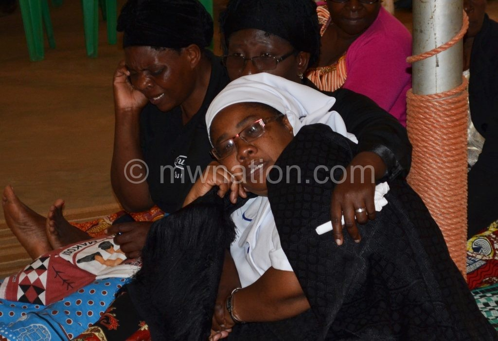 Mbendera's widow being consoled