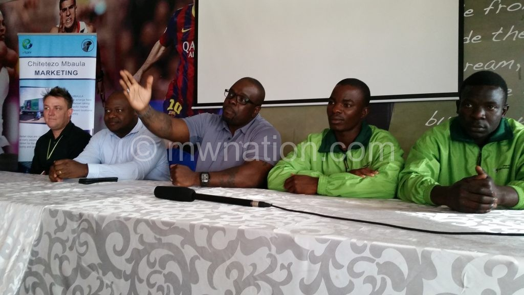Banda (C) speaks during the briefing as Matache (2ndR), Tewete (2ndL), Meyer (R) and Chewale look on