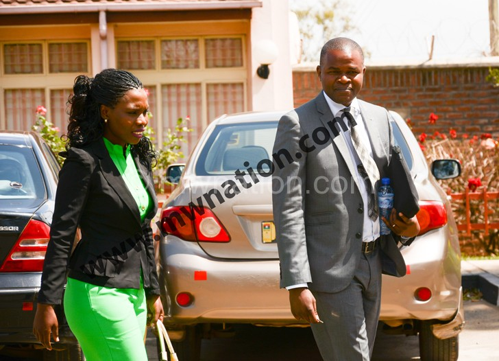 Ndanga (L) and Mazeze captured leaving Macra offices yesterday