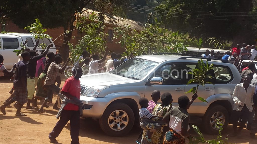 The villagers block one of the cars on Chaponda's convoy on Monday