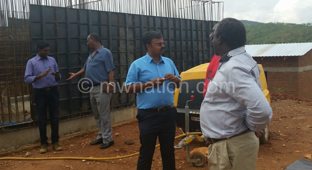 Mtawali with contractors at the construction site