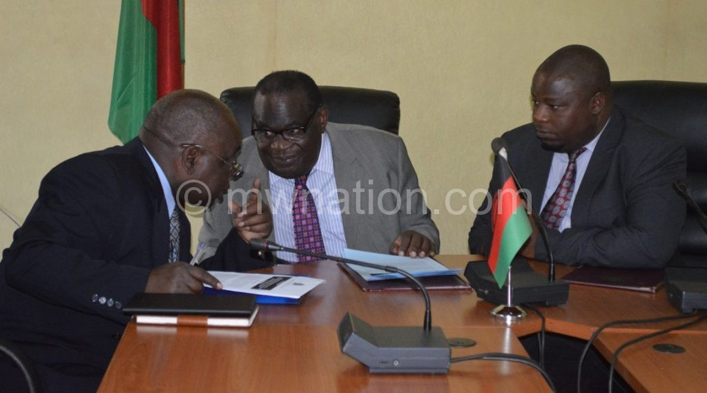 Gondwe (C), Nankhumwa (L) and another official confer during the meeting on Wednesday