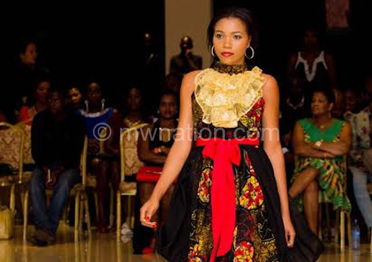 Niffat Lokosang walking on the runway for Nells Secret Possessions