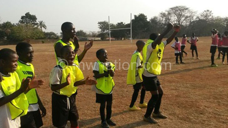 Inspiring: Ngalande (C) leads by example during a training session