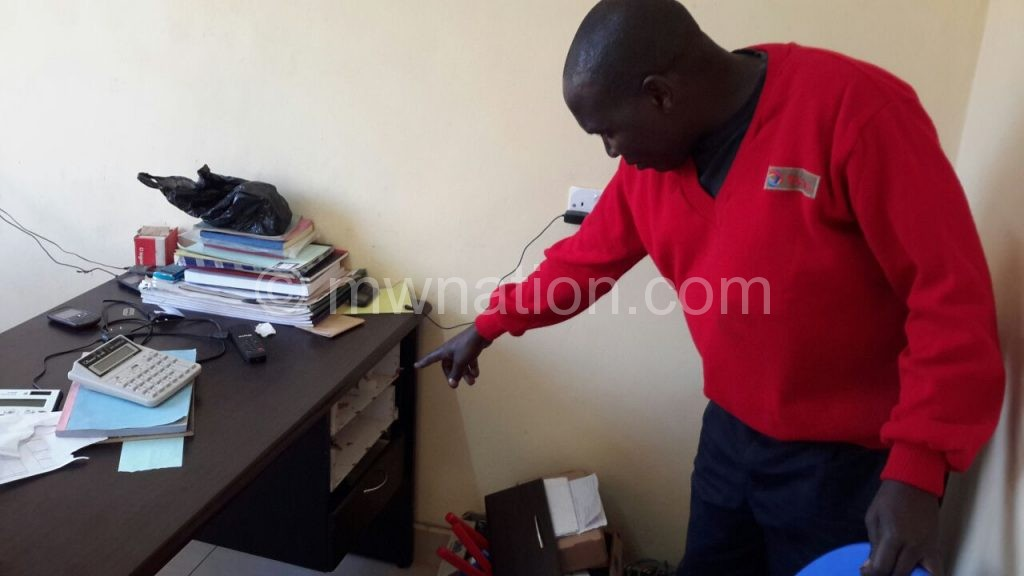 Msiska points to a drawer that contained office keys